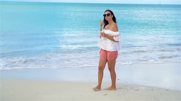 Thumbnail for Young Woman with Cup of Tea on the Beach. Girl Relax and Enjoy Holidays. SLOW MOTION