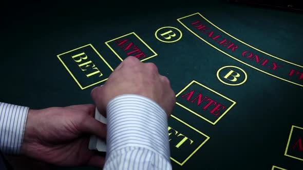 Thumbnail for Croupier Makes Fan in Hands Under Poker Table, Slow Motion