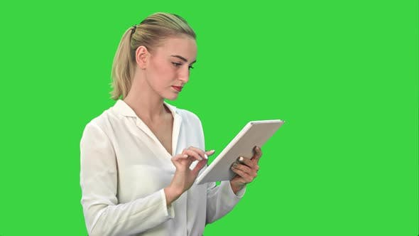 Thumbnail for Concentrated Businesswoman Standing with Digital Tablet on a Green Screen