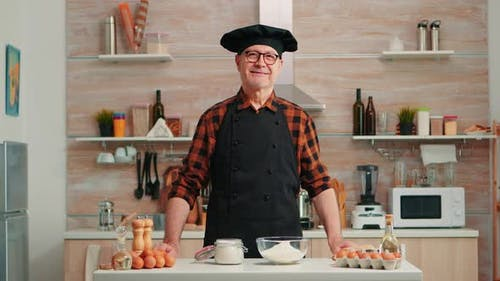 Portrait of Chef Wearing Bonete Looking at Camera