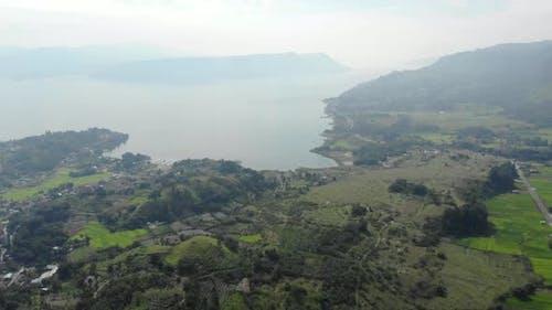 Aerial: lake Toba and Samosir Island from above Sumatra Indonesia.