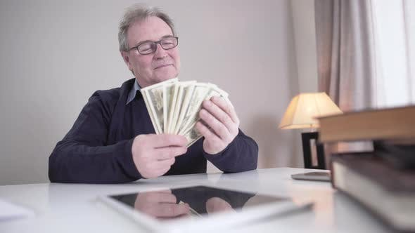 Thumbnail for Happy Senior Caucasian Man Holding Bunch of Dollar Banknotes and Waving Cash, Portrait of Wealthy