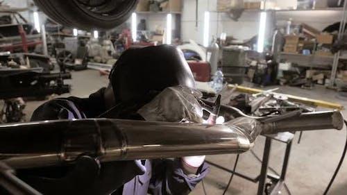 Welding Process.  A Man In Helmet Doing Argon Welding Parts