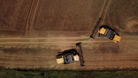 Thumbnail for Top Down View of Combine Harvesters Agricultural Machinery. The Machine for Harvesting Grain Crops