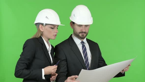Thumbnail for Engineers Studying Construction Blueprint Against Chroma Key