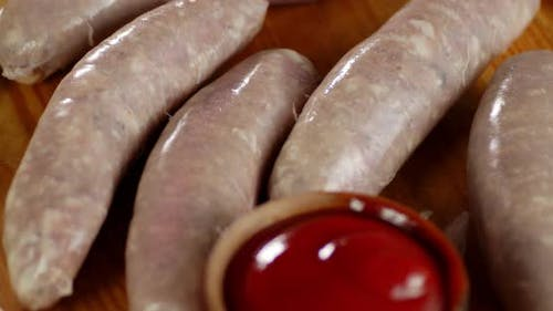 Raw Homemade Sausages with Onions and Sauce.