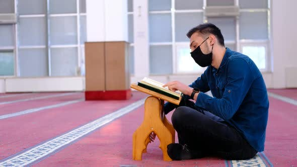 Man Masked Recite Quran Mosque