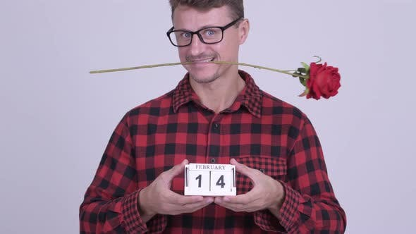 Thumbnail for Happy Bearded Hipster Man Holding Calendar Block Ready for Valentine's Day