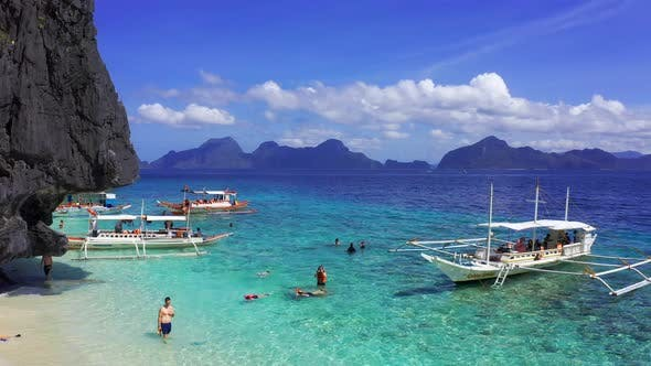 Cover Image for El Nido Palawan Philippines, Aerial View of Boats Moored at Secret Lagoon Beach.