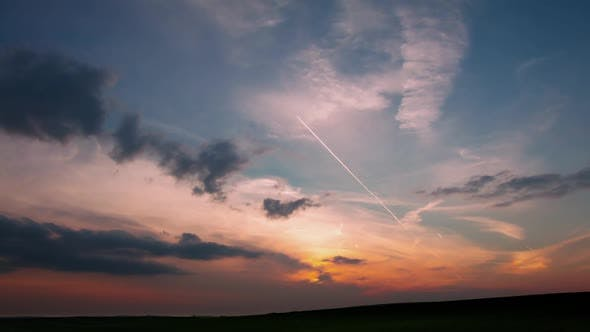 Thumbnail for Clouds and Traces of Planes on Sunset