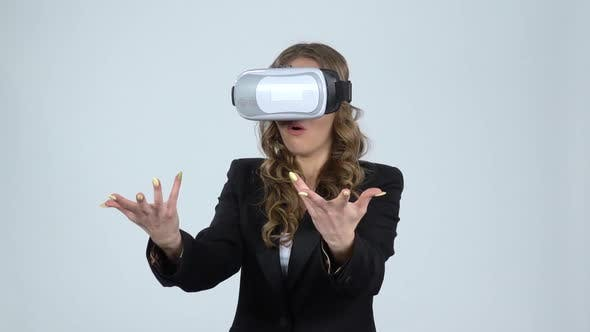 Thumbnail for Woman with Virtual Reality Glasses on Her Head on Gray Background, Slow Motion.