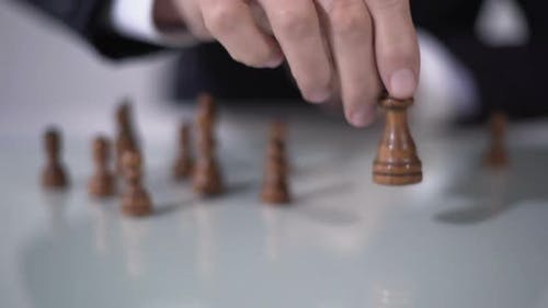 Man Making Winning Queen Move in Chess Game, Using Successful Business Strategy