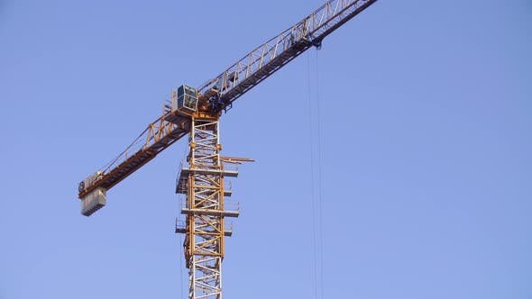 Thumbnail for Tower Crane Working on Construction Site Sunny Day Clear Blue Sky