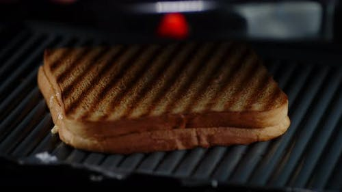 Roasted Bread for English Breakfast. On a Black Background.