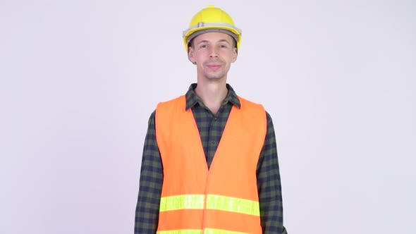 Thumbnail for Studio Shot of Happy Man Construction Worker Smiling