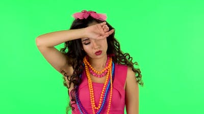 Woman Is Upset and Tired on Green Screen at Studio. Green Screen