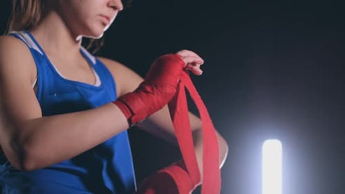 Woman Is Wrapping Hands with Yellow Boxing Wraps