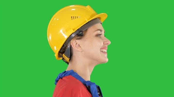 Thumbnail for The young woman engineer with yellow safety helmet walking