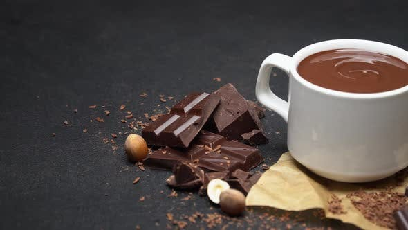 Thumbnail for Cup of Hot Chocolate and Pieces of Chocolate on Dark Concrete Background