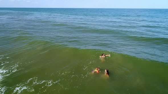 Thumbnail for Green Sea in Which Mom and Daughters Swim