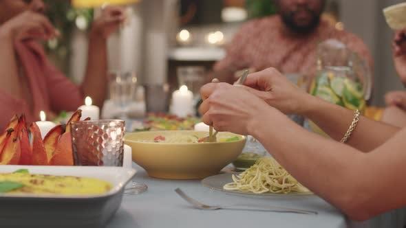 Eating Pasta At Family Dinner