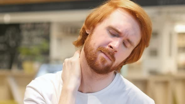 Thumbnail for Redhead Beard Man with Serious Neck Pain, Indoor