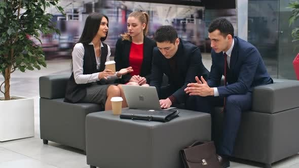 Cover Image for Business People Interacting in Lobby