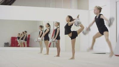 Girls Performing Cheerleading Moves