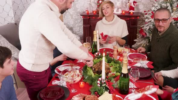 Thumbnail for Cheerful Big Family Celebrating Christmas at Dinner Table