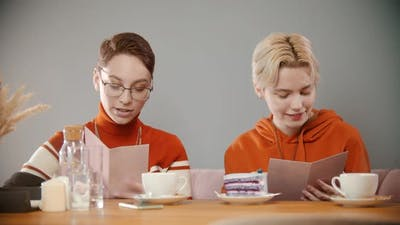 Girls Are Reading the Menu in the Cafe