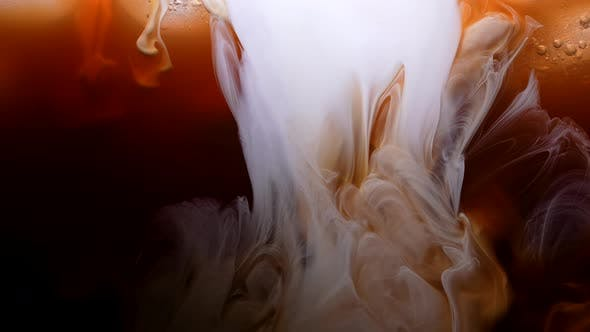 Cream or Milk is Poured Into Iced Coffee Frappe Frappuccino Iced Coffee