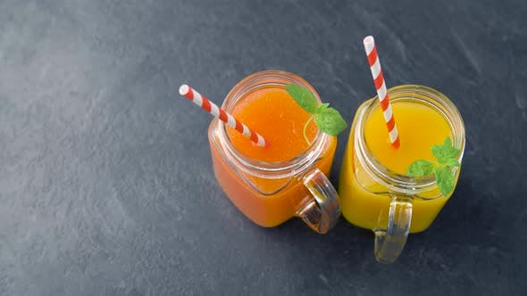 Thumbnail for Juices in Mason Jar Glasses with Paper Straws