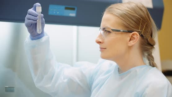 Scientist Analyzing Tubes at Laboratory