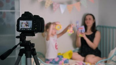 Woman with Daughter Filming Content for Vlog
