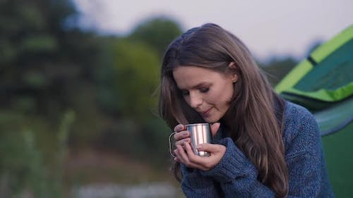 Camping. Tourist Woman Drinking Hot Beverage In Nature.