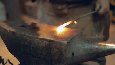 Blacksmith is Hammering the Iron