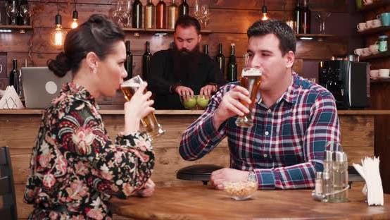 Thumbnail for Zoom Out Shot of Happy Inlove Couple Drinking Beer in Stylish Vintage Pub Restaurant