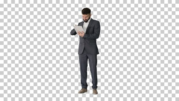 Thumbnail for Businessman standing and using tablet computer, Alpha Channel