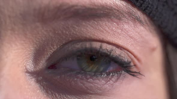 Extreme close-up of a woman eye blinking.