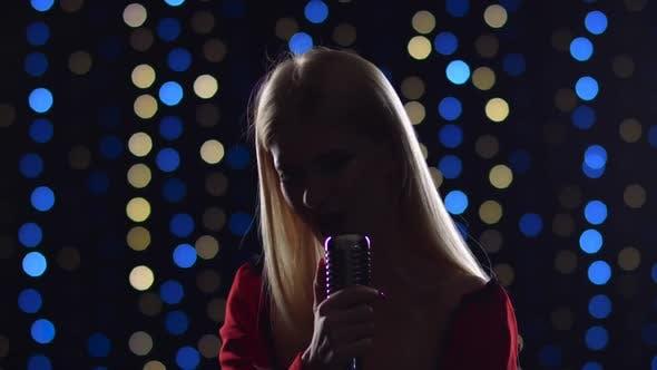 Girl Sings Energetic Songs in the Twilight
