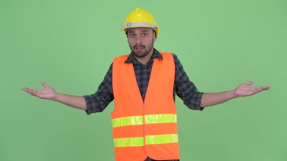 Cover Image for Confused Young Bearded Persian Man Construction Worker Shrugging Shoulders