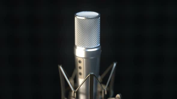Cover Image for Camera Approaches Professional Microphone in Sound Recording Studio