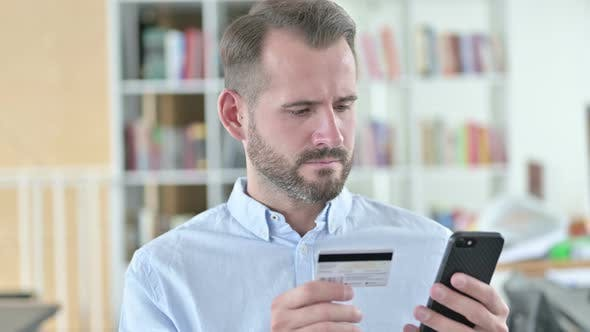 Thumbnail for Portrait of Online Payment Failure on Smartphone By Man
