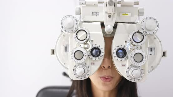 Thumbnail for Young asian woman doing eye test