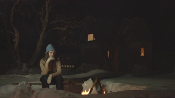 Sad girl sits alone.