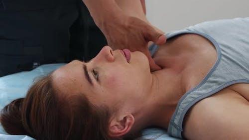 Woman Having an Osteopathic Treatment - Massagist Massaging Her Hand