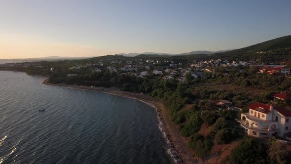 Thumbnail for - Aerial View of Sea and Shore with Resort Town at Sunset, Greece