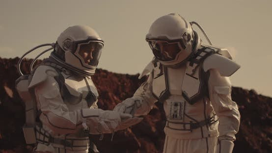 Thumbnail for Two Astronauts Examining Sample on Mars