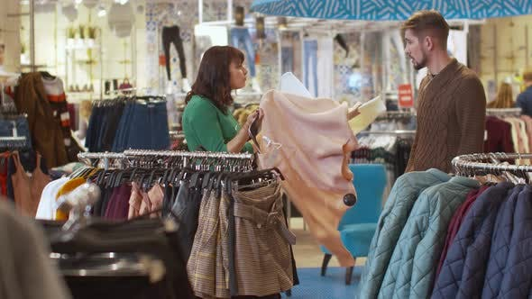 Cover Image for Young Couple Quarrel in Clothing Store