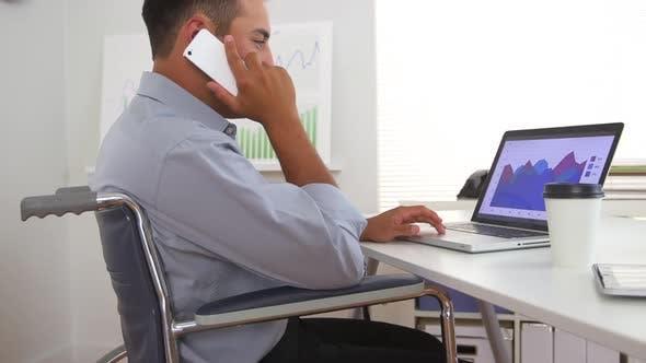 Thumbnail for Hispanic business man in wheelchair using laptop